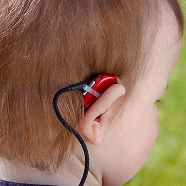 child wearing hearing aid
